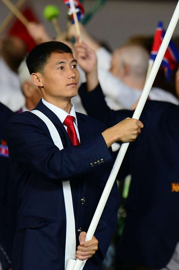North Korea's flagbearer Pak Song-Chol leads his delegation during the opening ceremony of the London 2012 Olympic Games on July 27, 2012 at the Olympic Stadium in London.   AFP PHOTO / OLIVIER MORINOLIVIER MORIN/AFP/GettyImages Photo: Olivier Morin, AFP/Getty Images