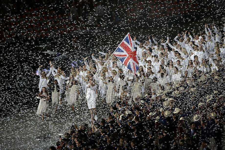 Britain's Chris Hoy carries the flag during the Opening Ceremony at the 2012 Summer Olympics, Friday, July 27, 2012, in London. (AP Photo/Paul Sancya) Photo: Paul Sancya, Associated Press