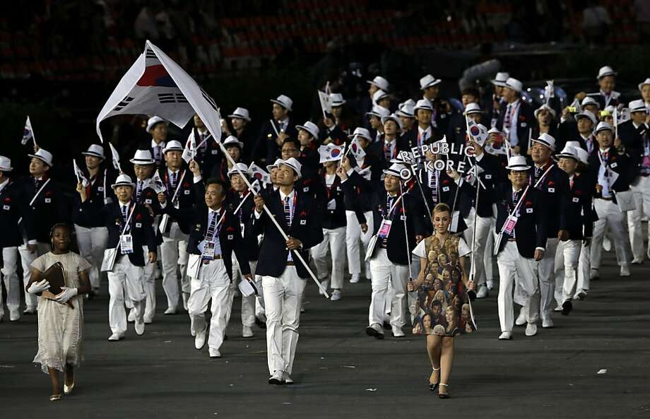 South Korea's Yoon Kyung-shin carries the flag during the Opening Ceremony at the 2012 Summer Olympics, Friday, July 27, 2012, in London. (AP Photo/Mark Humphrey) Photo: Mark Humphrey, Associated Press