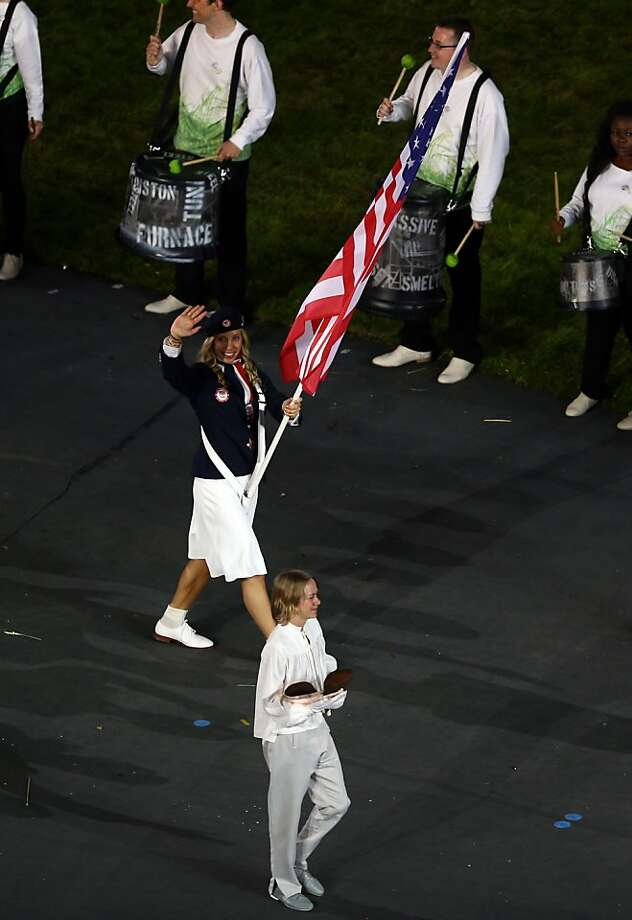 LONDON, ENGLAND - JULY 27: Mariel Zagunis of the United States Olympic fencing team carries her country's flag during the Opening Ceremony of the London 2012 Olympic Games at the Olympic Stadium on July 27, 2012 in London, England.  (Photo by Paul Gilham/Getty Images) Photo: Paul Gilham, Getty Images