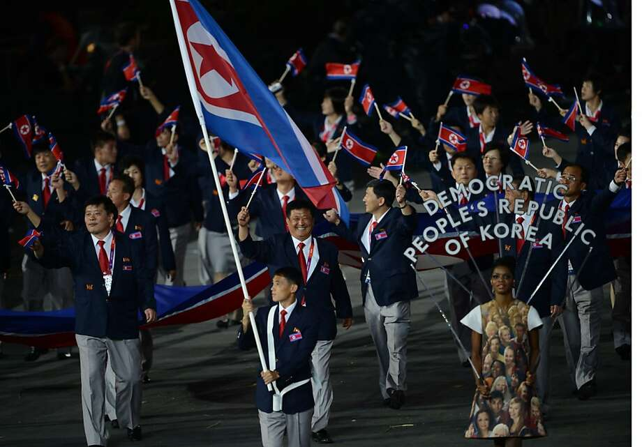 North Korea's flagbearer Pak Song-Chol leads his delegation parade in the opening ceremony of the London 2012 Olympic Games in the Olympic Stadium in London on July 27, 2012.  AFP PHOTO / CHRISTOPHE SIMONCHRISTOPHE SIMON/AFP/GettyImages Photo: Christophe Simon, AFP/Getty Images