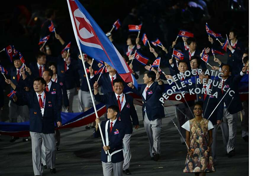 North Korea's flagbearer Pak Song-Chol leads his delegation parade in the opening ceremony of the Lo
