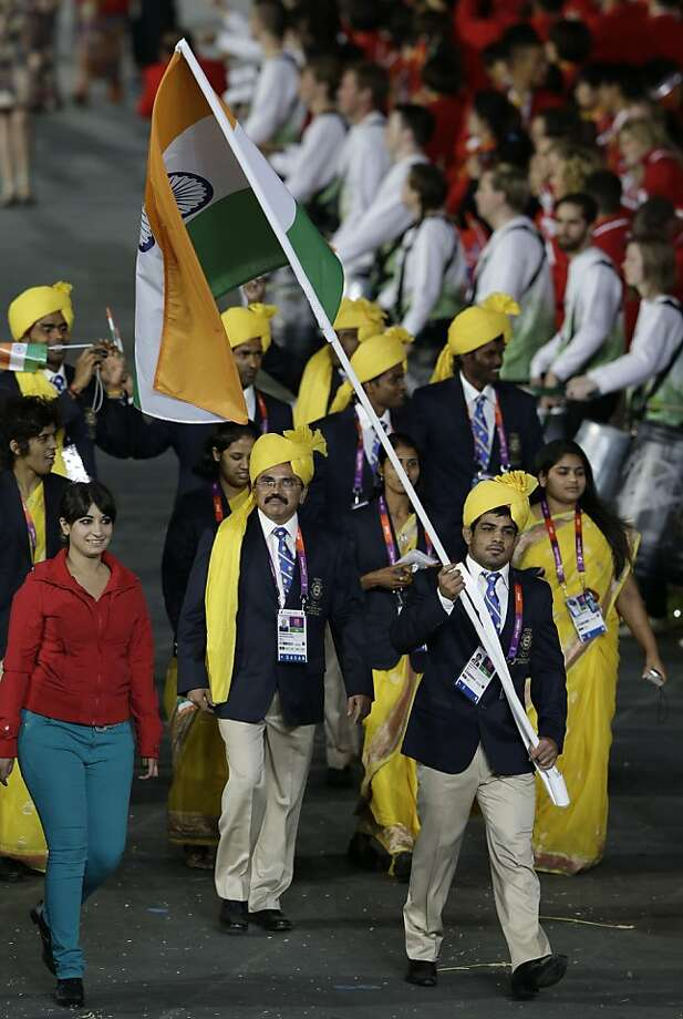 India's Sushil Kumar carries the flag during the Opening Ceremony at the 2012 Summer Olympics, Friday, July 27, 2012, in London. (AP Photo/Mark Humphrey) Photo: Mark Humphrey, Associated Press