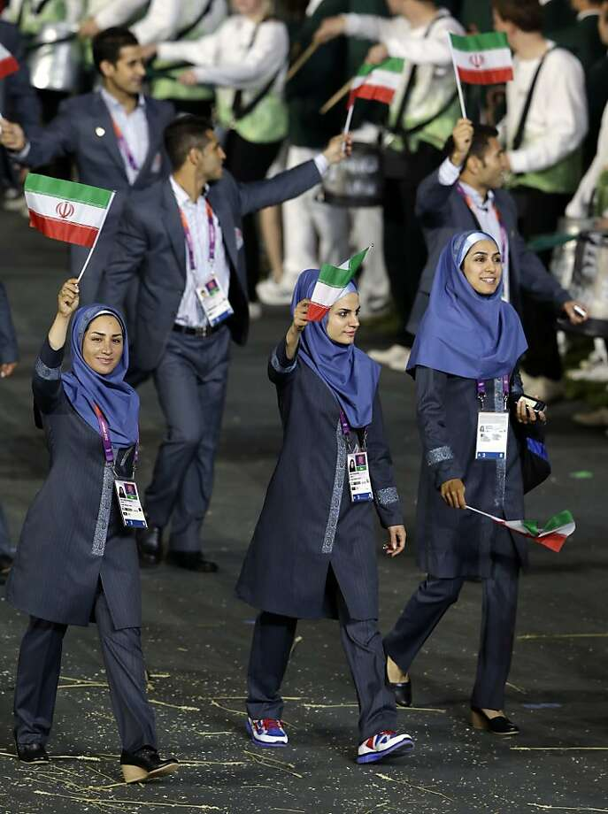 Iranian athletes wave their national flag and walk in a parade during the Opening Ceremony at the 2012 Summer Olympics, Friday, July 27, 2012, in London. (AP Photo/Mark Humphrey) Photo: Mark Humphrey, Associated Press