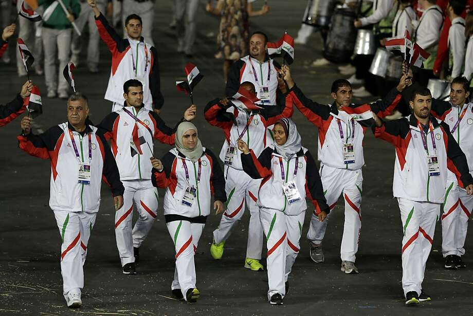 Iraq's athletes walk in a parade during the Opening Ceremony at the 2012 Summer Olympics, Friday, July 27, 2012, in London. (AP Photo/Mark Humphrey) Photo: Mark Humphrey, Associated Press
