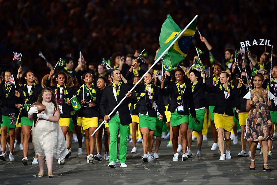 LONDON, ENGLAND - JULY 27:  Rodrigo Pessoa of the Brazil Olympic equestrian team carries his country's flag during the Opening Ceremony of the London 2012 Olympic Games at the Olympic Stadium on July 27, 2012 in London, England.  (Photo by Lars Baron/Getty Images) Photo: Lars Baron, Getty Images