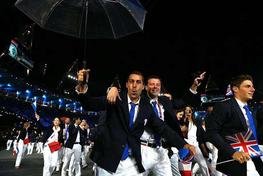 LONDON, ENGLAND - JULY 27:  Members of the French Olympic team enter the stadium during the Opening Ceremony of the London 2012 Olympic Games at the Olympic Stadium on July 27, 2012 in London, England.  (Photo by Cameron Spencer/Getty Images) Photo: Cameron Spencer, Getty Images
