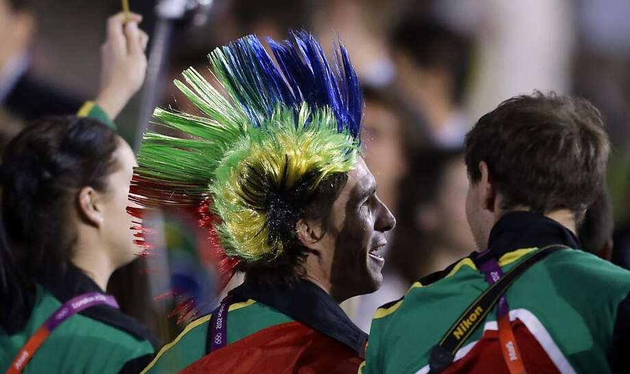 South African athletes parade during the Opening Ceremony at the 2012 Summer Olympics, Friday, July 27, 2012, in London. (AP Photo/David Goldman) Photo: David Goldman, Associated Press