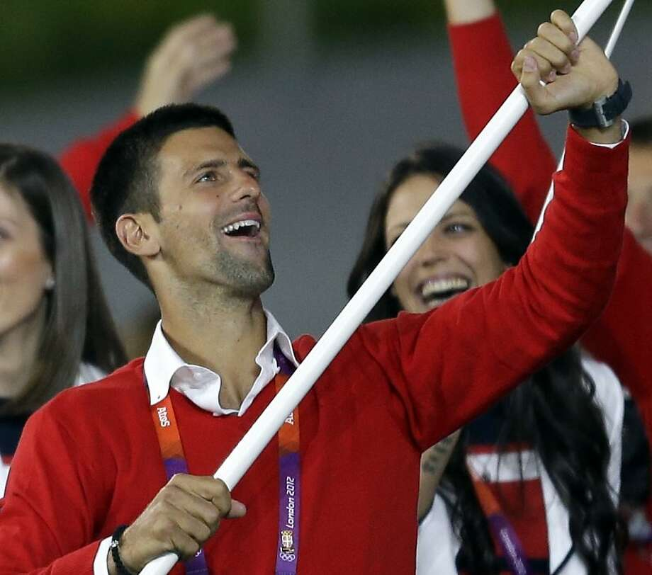 Serbia's Novak Djokovic carries the flag during the Opening Ceremony at the 2012 Summer Olympics, Friday, July 27, 2012, in London. (AP Photo/David Goldman) Photo: David Goldman, Associated Press