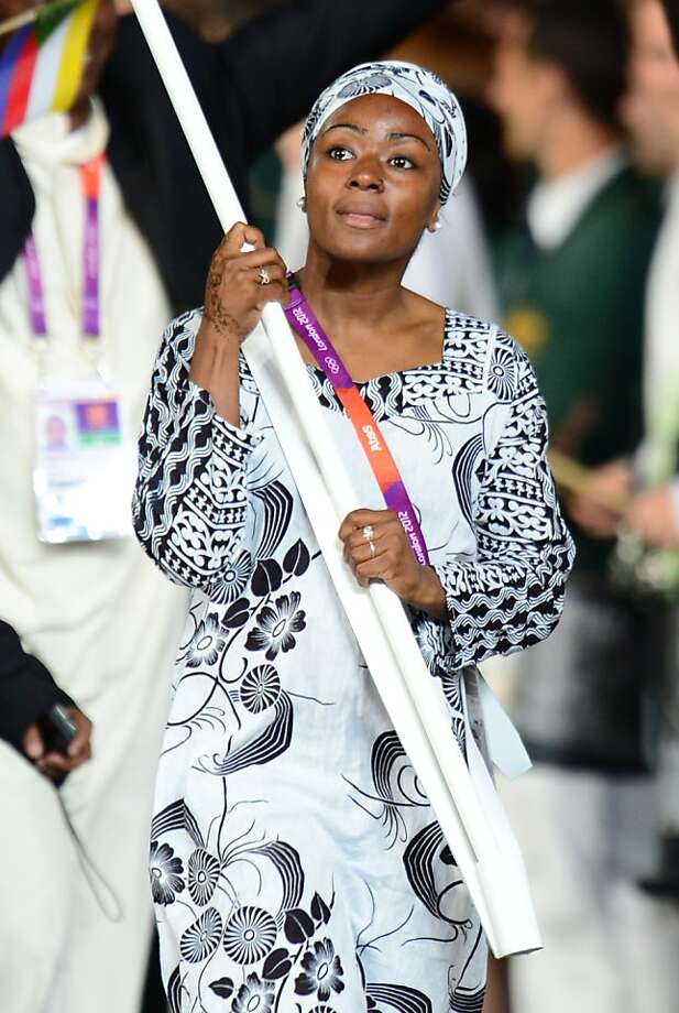 Comoros's flagbearer Feta Ahamada leads her delegation during the opening ceremony of the London 2012 Olympic Games on July 27, 2012 at the Olympic Stadium in London.     AFP PHOTO / OLIVIER MORINOLIVIER MORIN/AFP/GettyImages Photo: Olivier Morin, AFP/Getty Images