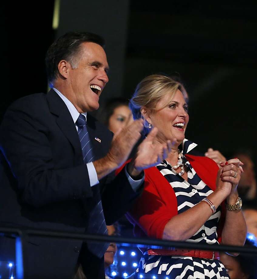U.S. Republican Presidential candidate Mitt Romney, left, and his wife Ann applaud as the USA team enters the stadium during the Opening Ceremony at the 2012 Summer Olympics, Friday, July 27, 2012, in London. (AP Photo/Jae C. Hong) Photo: Jae C. Hong, Associated Press