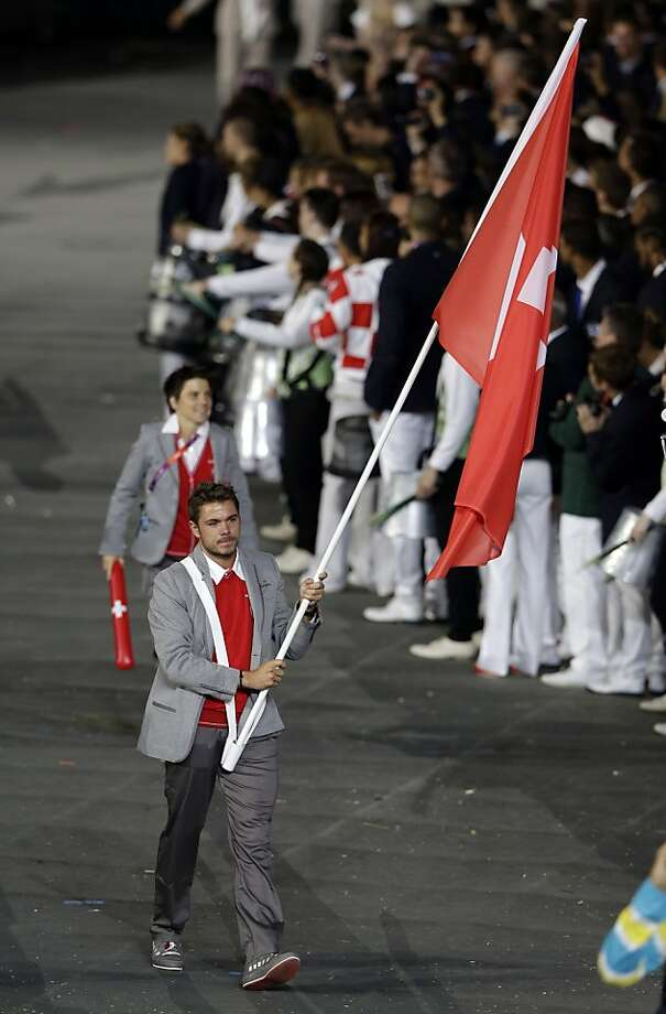 Switzerland's Stanislas Wawrinka carries the flag during the Opening Ceremony at the 2012 Summer Olympics, Friday, July 27, 2012, in London. (AP Photo/Mark Humphrey) Photo: Mark Humphrey, Associated Press