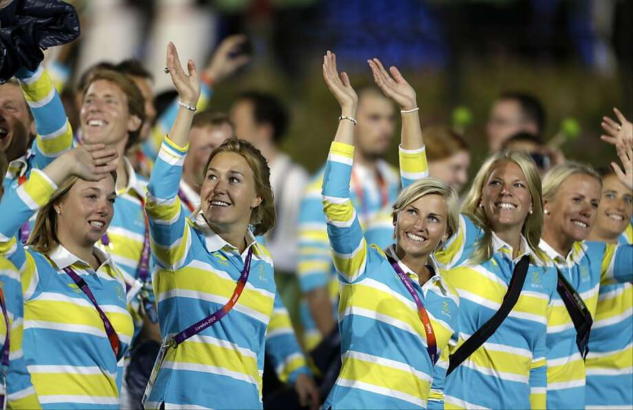 Swedish athletes parade during the Opening Ceremony at the 2012 Summer Olympics, Friday, July 27, 2012, in London. (AP Photo/David Goldman) Photo: David Goldman, Associated Press