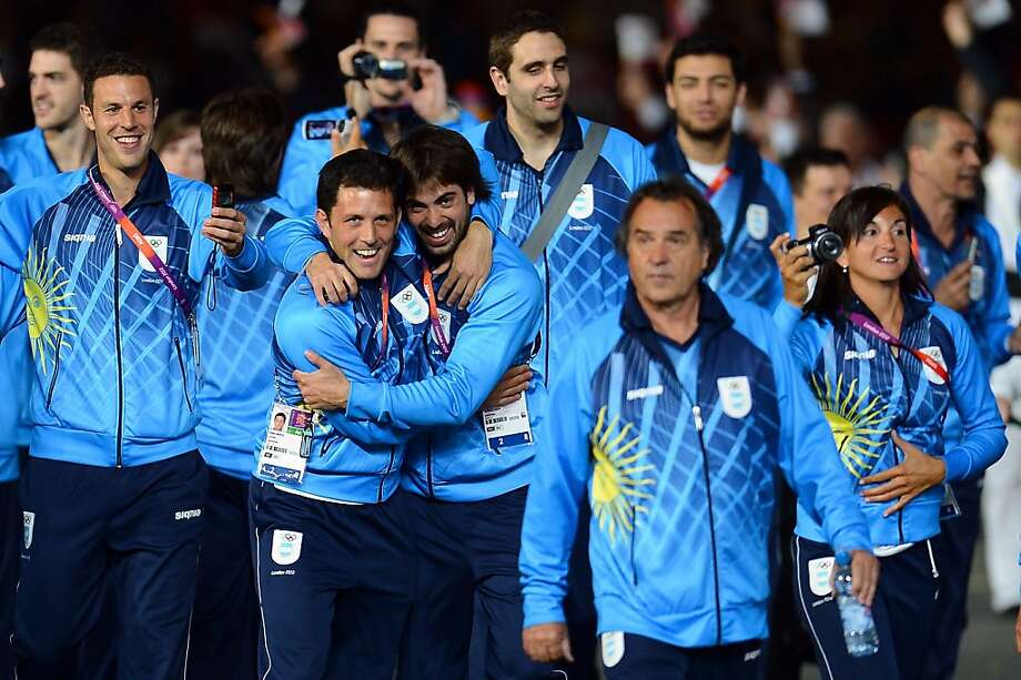 LONDON, ENGLAND - JULY 27:  Members of the Argentina team embrace as they parade into the stadium during the Opening Ceremony of the London 2012 Olympic Games at the Olympic Stadium on July 27, 2012 in London, England.  (Photo by Lars Baron/Getty Images) Photo: Lars Baron, Getty Images
