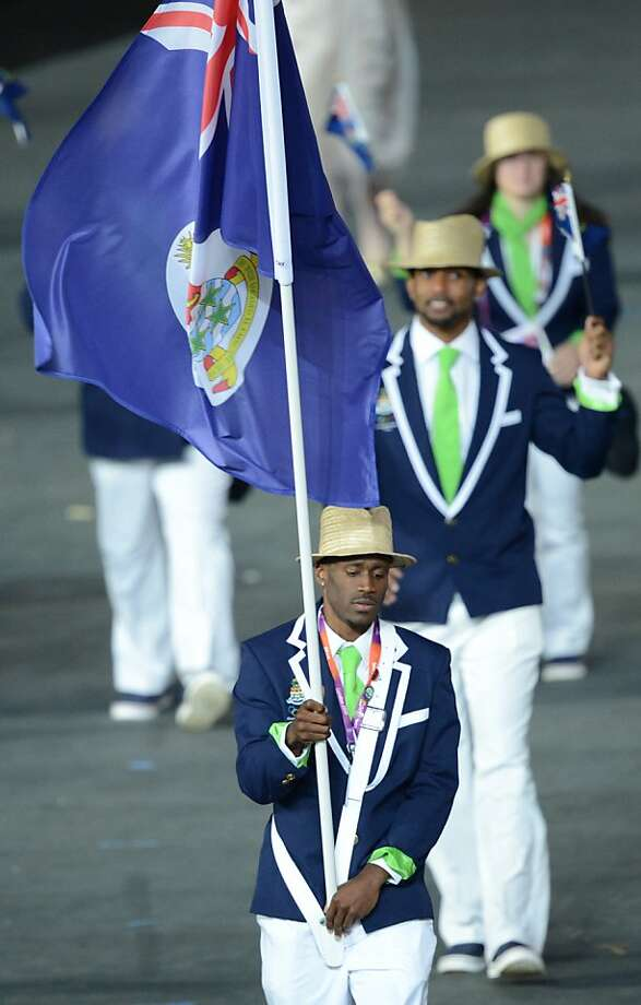 Cayman Islands' flagbearer Kemar Hyman carries the flag as he leads his delegation parade during the opening ceremony of the London 2012 Olympic Games in the Olympic Stadium in London on July 27, 2012.  AFP PHOTO / CHRISTOPHE SIMONCHRISTOPHE SIMON/AFP/GettyImages Photo: Christophe Simon, AFP/Getty Images