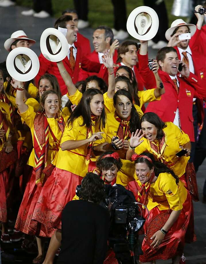 Spanish athletes pose for a camera operator as they parade during the Opening Ceremony at the 2012 Summer Olympics, Friday, July 27, 2012, in London. (AP Photo/Jae C. Hong) Photo: Jae C. Hong, Associated Press