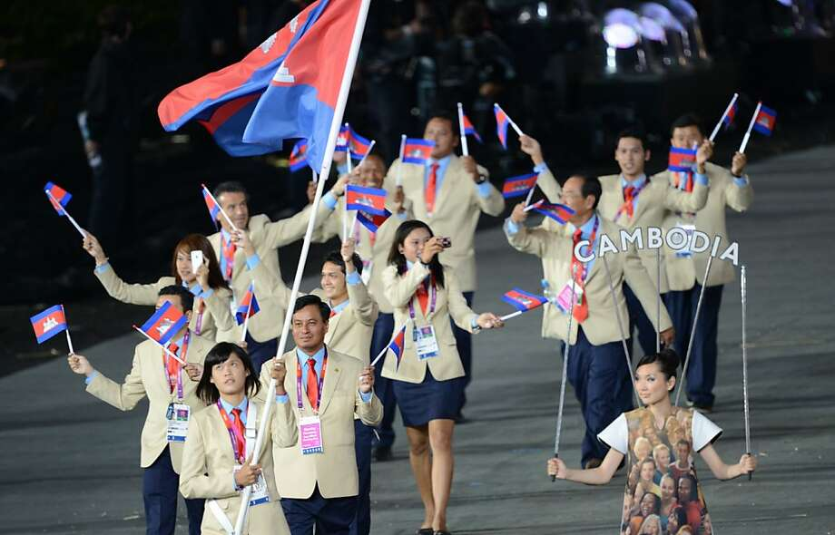 Cambodia's flagbearer Davin Sorn carries the flag as she leads her delegation during the opening ceremony of the London 2012 Olympic Games in the Olympic Stadium in London on July 27, 2012.  AFP PHOTO / CHRISTOPHE SIMONCHRISTOPHE SIMON/AFP/GettyImages Photo: Christophe Simon, AFP/Getty Images