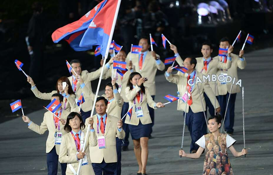 Cambodia's flagbearer Davin Sorn carries the flag as she leads her delegation during the opening cer