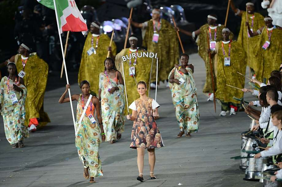 Burundi's flagbearer Diane Nukuri carries the flag as she leads her delegation during the opening ceremony of the London 2012 Olympic Games in the Olympic Stadium in London on July 27, 2012.  AFP PHOTO / CHRISTOPHE SIMONCHRISTOPHE SIMON/AFP/GettyImages Photo: Christophe Simon, AFP/Getty Images