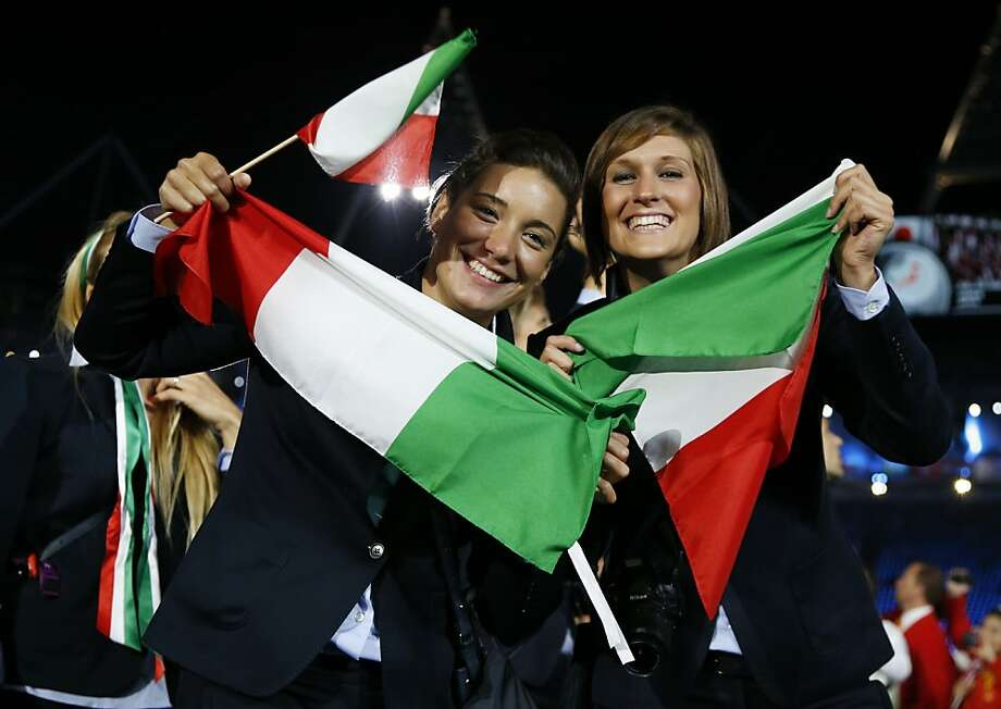 Italian athletes pose for a photograph as they parade during the Opening Ceremony at the 2012 Summer Olympics, Friday, July 27, 2012, in London. (AP Photo/Matt Dunham) Photo: Matt Dunham, Associated Press