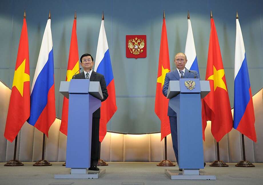 Russian President Vladimir Putin (R) and  his Vietnamese couterpart Truong Tan Sang attend a joint press conference in Moscow on July 27, 1012.  Russia is holding talks about opening naval bases in Moscow's Soviet-era allies Cuba and Vietnam as well as the Seychelles, the commander-in-chief of the Russian Navy said.   AFP PHOTO/ RIA-NOVOSTI/ ALEXEY DRUZHININALEXEY DRUZHININ/AFP/GettyImages Photo: Alexey Druzhinin, AFP/Getty Images