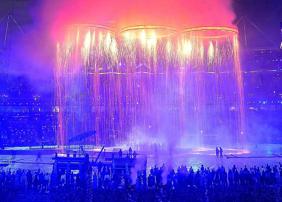 The Olympic rings shower sparks over the stage during the Opening Ceremony for the London 2012 Summer Olympic Games at the Olympic Stadium in London, England, Friday, July 27, 2012. (David Eulitt/Kansas City Star/MCT) Photo: David Eulitt, McClatchy-Tribune News Service