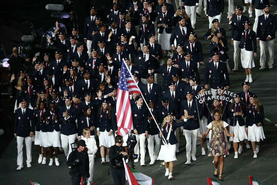 Fencer Mariel Zagunis leads the U.S. team at the opening ceremony. Local resident and track coach Rose Monday wasn't allowed to go, but she was OK with that. Photo: Quinn Rooney, Getty Images / 2012 Getty Images