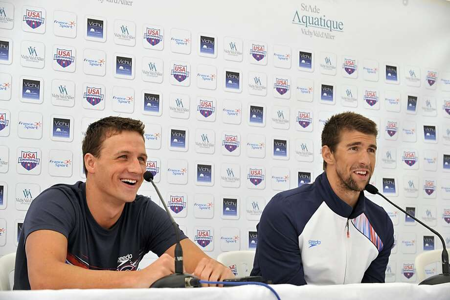 US swimmers Ryan Lochte (L) and Michael Phelps give a press conference after a training session, on July 21, 2012, during a training camp of the US swimming team in Bellerive-sur-Allier, central France, six days ahead of the London Olympic Games. AFP PHOTO THIERRY ZOCCOLANTHIERRY ZOCCOLAN/AFP/GettyImages Photo: Thierry Zoccolan, AFP/Getty Images