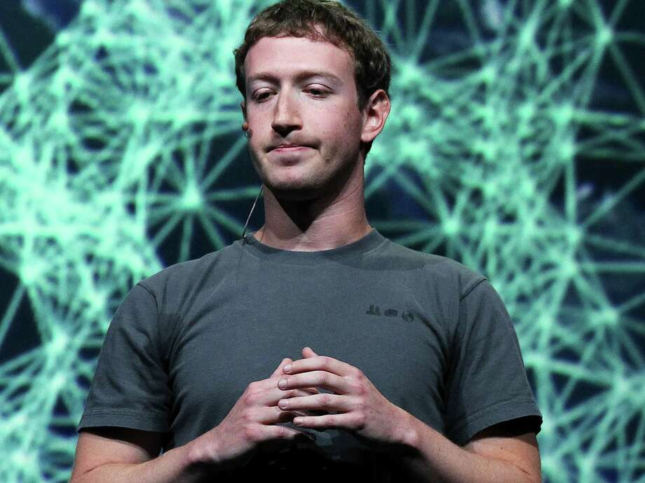 FILE - JULY 26: Facebook has announced it's first earnings as a public company on July 26, 2012 in New York City. Revenue beat Wall Street expectations although shares fell 2.4 percent to $26.19, 29 percent down from it's IPO. Advertising revenue went up 28 percent to %992 million with costs and expensese rising to $1.93 million.   SAN FRANCISCO, CA - SEPTEMBER 22:  Facebook CEO Mark Zuckerberg pauses as he delivers a keynote address during the Facebook f8 conference on September 22, 2011 in San Francisco, California. Facebook CEO Mark Zuckerberg kicked off the conference introducing a Timeline feature to the popular social network.  (Photo by Justin Sullivan/Getty Images) Photo: Justin Sullivan