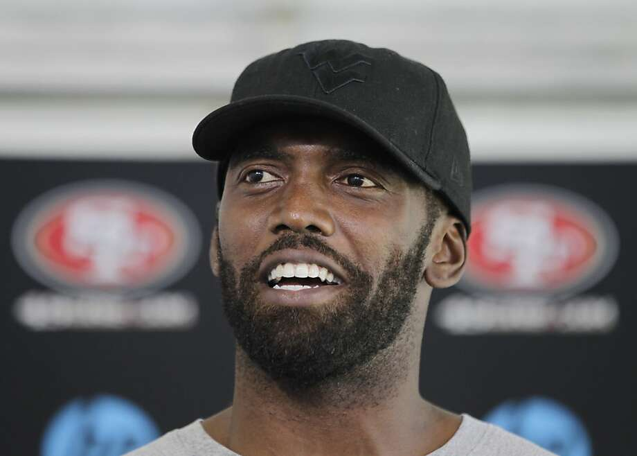 San Francisco 49ers  wide receiver Randy Moss smiles during a news conference at NFL football headquarters in Santa Clara, Calif., Friday, July 27, 2012. (AP Photo/Paul Sakuma) Photo: Paul Sakuma, Associated Press