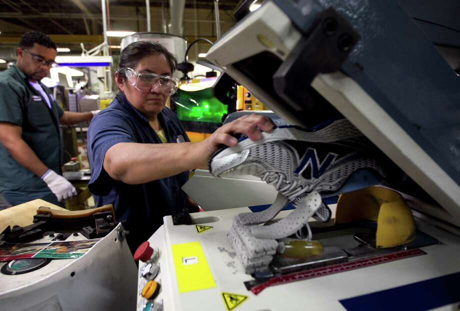 FILE - In this Tuesday, May 1, 2012, file photo, worker Maria Contrero, of Boston, removes an elite running shoe from a sole press during the assembly process at the New Balance Athletic Shoe, Inc. factory in Boston. A U.S. economy that plodded along in the first three months of the year likely grew even less in the April-June quarter. And most economists no longer think growth will strengthen much in the second half of 2012.  (AP Photo/Steven Senne, File) Photo: Steven Senne
