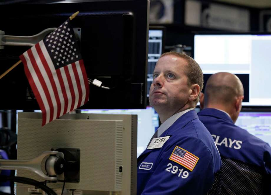 Specialist Robert Nelson works on the floor of the New York Stock Exchange Thursday, July 26, 2012. The Dow Jones industrial average on Thursday jumped 212 points following big gains in European markets.  (AP Photo/Richard Drew) Photo: Richard Drew