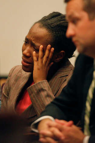 Tiffany James cries during the closing arguments of the punishment phase of her trial for the death of Antwan Wolford in the Bexar County 399th District Court on Friday, July 27, 2012. James was found guilty of manslaughter Thursday night. At right is defense attorney Robert Gebbia. Photo: Lisa Krantz, San Antonio Express-News / San Antonio Express-News
