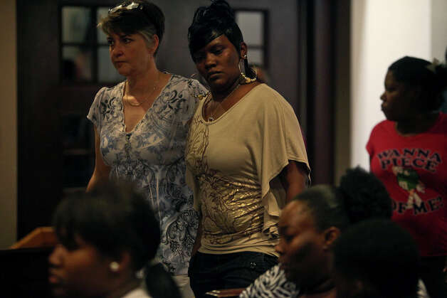 Victim advocate Stacia Rogers, left, walks Eashonne Wolford, the mother of Antwan Wolford, into the courtroom to give testimony during the punishment phase of Tiffany James' trial for the death of Wolford in the Bexar County 399th District Court on Friday, July 27, 2012. James was found guilty of manslaughter Thursday night. Photo: Lisa Krantz, San Antonio Express-News / San Antonio Express-News