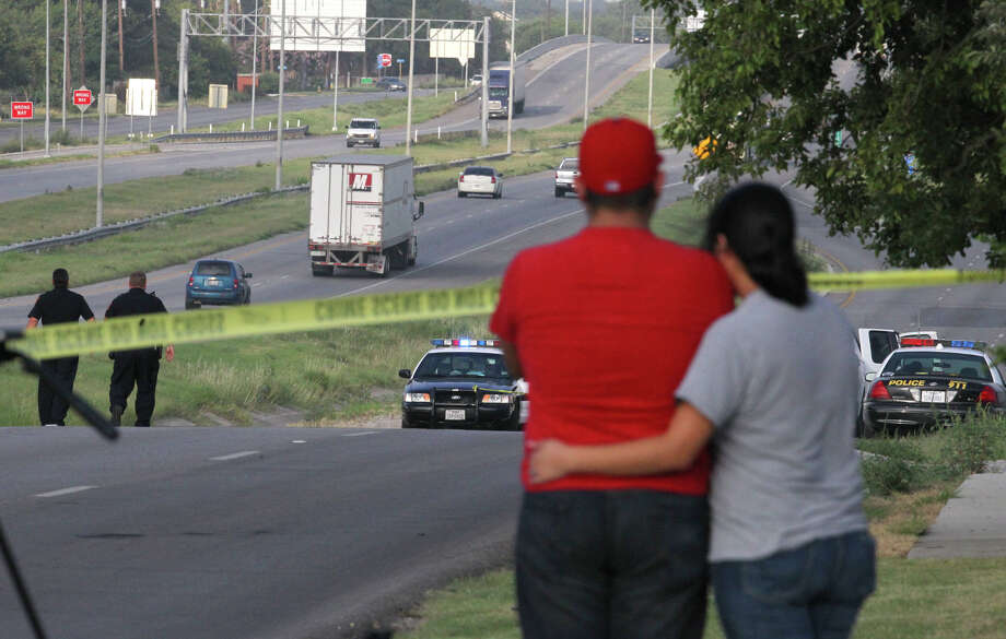 Police work at the scene of a fatal hit and run accident that took place last night on the southbound feeder road of Interstate 35 near the exit to the Poteet Jourdanton highway. Family members discovered the body of a female relative just before dawn after she decided to walk home last night from a restaurant. There were skid marks in the area indicating she'd been struck by a vehicle officials said. Photo: San Antonio Express-News
