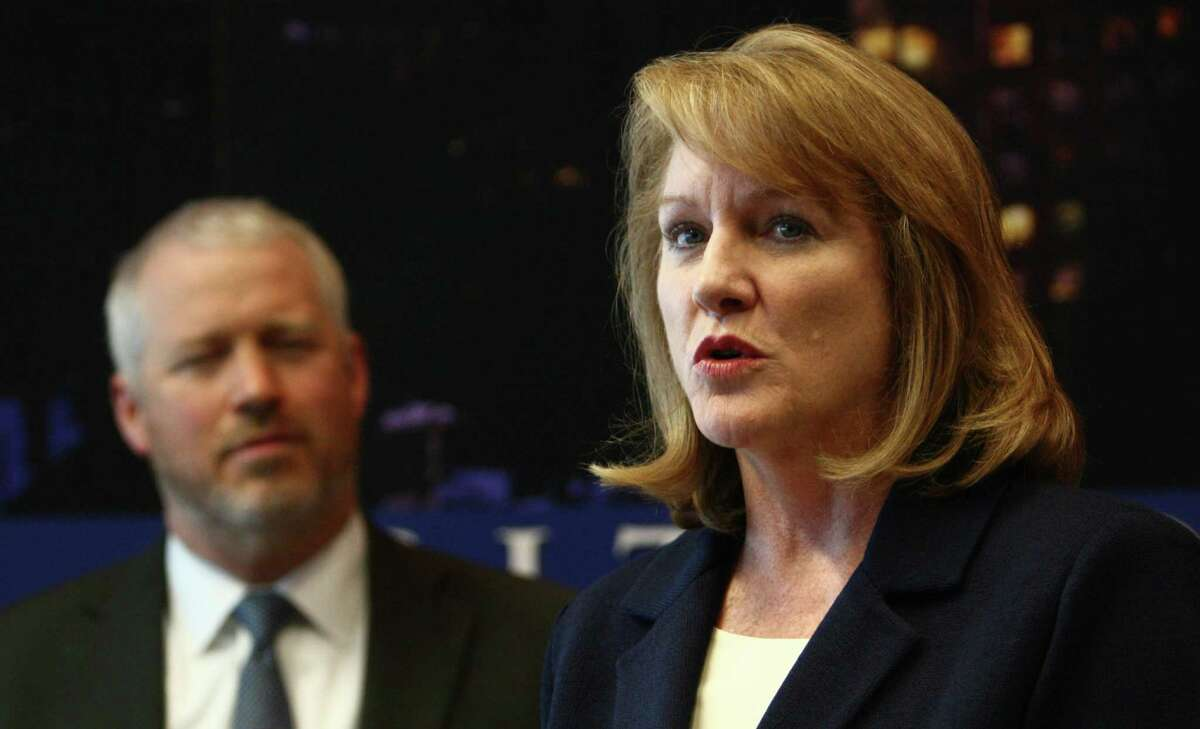 Jenny Durkan, U.S. Attorney for Seattle, speaks alongside Seattle Mayor Mike McGinn as the City of Seattle and U.S. Department of Justice hold a joint briefing to announce an agreement on police reforms on Friday, July 27, 2012. Officials agreed to an independent monitor and court oversight of the city's police department as part of the agreement.