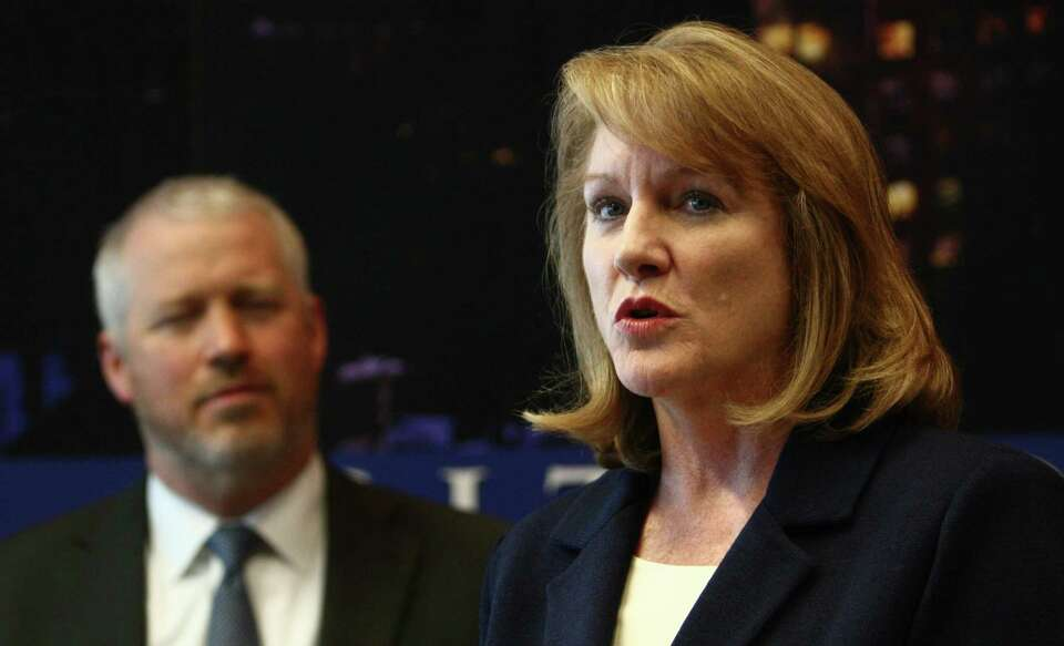 Jenny Durkan, U.S. Attorney for Seattle, speaks alongside Seattle Mayor Mike McGinn as the City of S