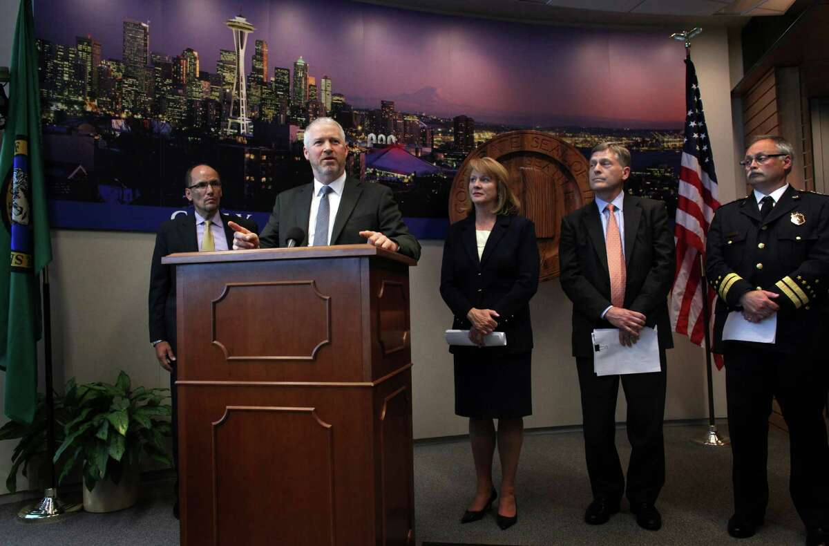 From left, Thomas Perez, the Justice Department's chief civil rights enforcer, Seattle Mayor Mike McGinn, Jenny Durkan, U.S. Attorney for Seattle, Seattle City Attorney Pete Holmes, and Seattle Police Chief John Diaz participate in a joint briefing to announce an agreement on police reforms between the City of Seattle and the U.S. Department of Justice on Friday, July 27, 2012. Officials agreed to an independent monitor and court oversight of the city's police department as part of the agreement.
