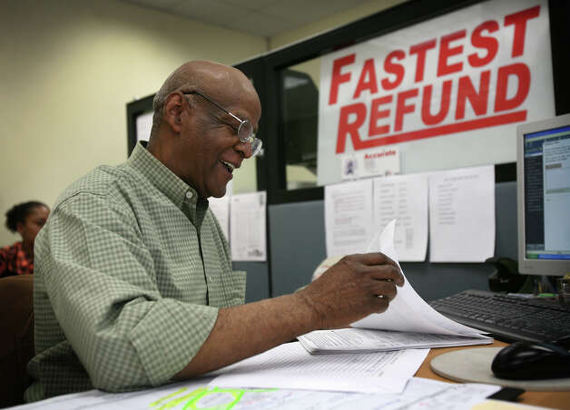 Tax advisor Eugene Eady of Bridgeport works on a client's taxes on the final day of filing at Liberty Tax Service at 100 Fairfield Avenue in Bridgeport on Tuesday, April 17, 2012. Photo: Brian A. Pounds / Connecticut Post