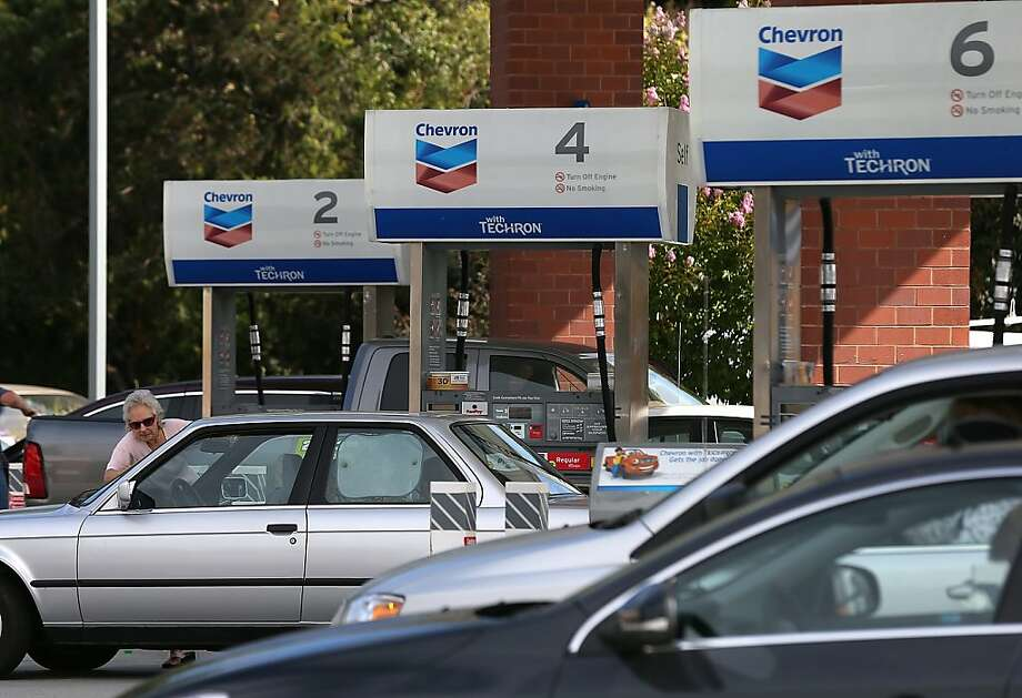 GREENBRAE, CA - JULY 27:  Customers fuel their cars at a Chevron gas station on July 27, 2012 in Greenbrae, California.  Chevron reported a 6.8 percent decline in second quarter earnings with profits of $7.21 billion compared to $7.73 billion one year ago.  (Photo by Justin Sullivan/Getty Images) Photo: Justin Sullivan, Getty Images