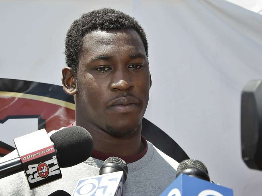 "San Francisco 49ers linebacker Aldon Smith apologies during a news conference at NFL football headquarters in Santa Clara, Calif., Friday, July 27, 2012. In his first public comments since he was stabbed at his home last month, Smith said Friday that ""letting everybody down was probably the saddest part."" He also was charged in late January with driving under the influence in Miami Beach. (AP Photo/Paul Sakuma) Photo: Paul Sakuma, Associated Press"