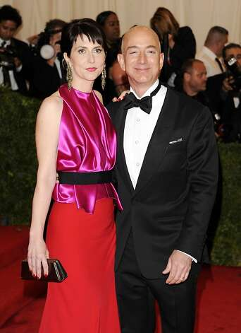 In a Monday, May 7, 2012 file photo, Amazon founder, president and CEO Jeff Bezos and wife Mackenzie Bezos arrive at the Metropolitan Museum of Art Costume Institute gala benefit, celebrating Elsa Schiaparelli and Miuccia Prada, in New York. Bezos and his wife MacKenzie announced a gift Friday, July 27, 2012 of $2.5 million to the campaign to defend Washington's same-sex marriage law.   (AP Photo/Evan Agostini, File) Photo: Evan Agostini, Associated Press