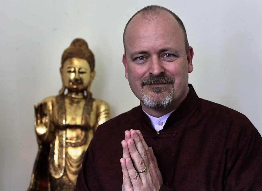Evan Kavanagh, sits in his living room,  Sunday July 22, 2012, at his home in San Francisco, Calif. Kavanagh is a Buddhist minister who performs weddings in addition to a full-time job at UCSF where he is a director of development at the Osher Center. Photo: Lacy Atkins, The Chronicle