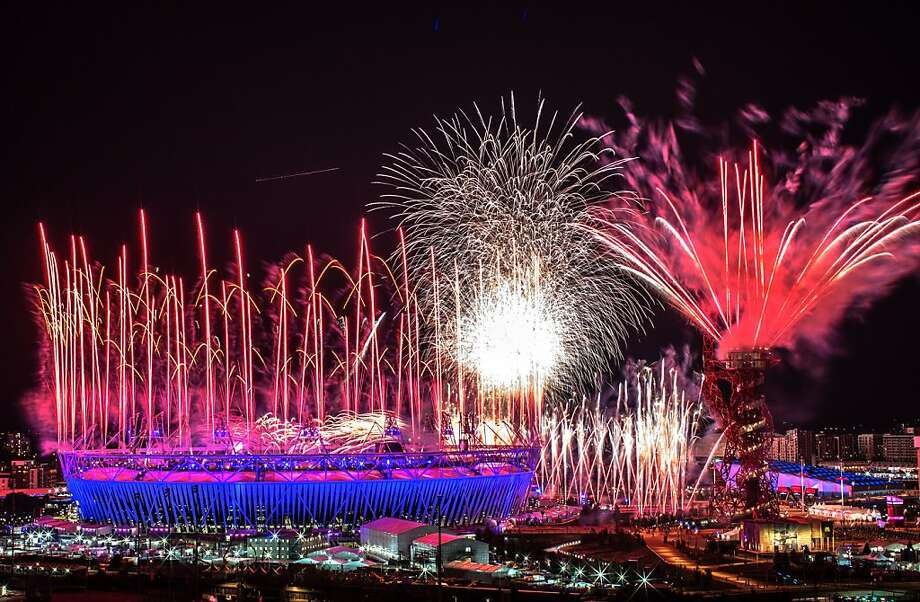 LONDON, ENGLAND - JULY 27: Fireworks explode over the Olympic Stadium during the opening ceremony of the 2012 London Olympic Games on July 27, 2012 in London, England. Athletes, heads of state and dignitaries from around the world have gathered in the Olympic Stadium for the opening ceremony of the 30th Olympiad. London plays host to the 2012 Olympic Games which will see 26 sports contested by 10,500 athletes over 17 days of competition. (Photo by Daniel Berehulak/Getty Images) Photo: Daniel Berehulak, Getty Images