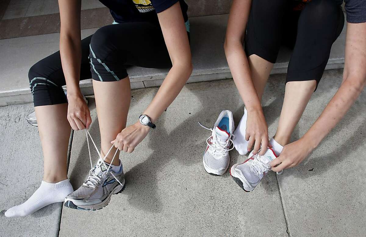 The Welch sisters prepare for a workout in front of their apartment building. Jackie and Becky Welch, sisters who live in San Francisco, Calif., will be running their first half marathon, a popular run distance, during this years San Francisco Marathon.