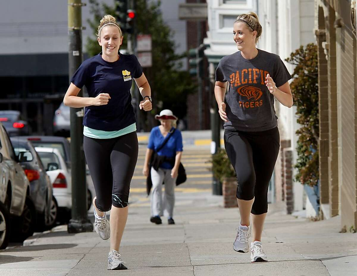 Becky Welch (left) and her sister Jackie Welch (right) head up Polk Street, working out for the upcoming marathon. Jackie and Becky Welch, sisters who live in San Francisco, Calif., will be running their first half marathon, a popular run distance, during this years San Francisco Marathon.