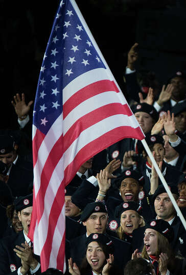 USA athletes wave to the crowd as they enter the stadium during the opening ceremony for the 2012 Lo