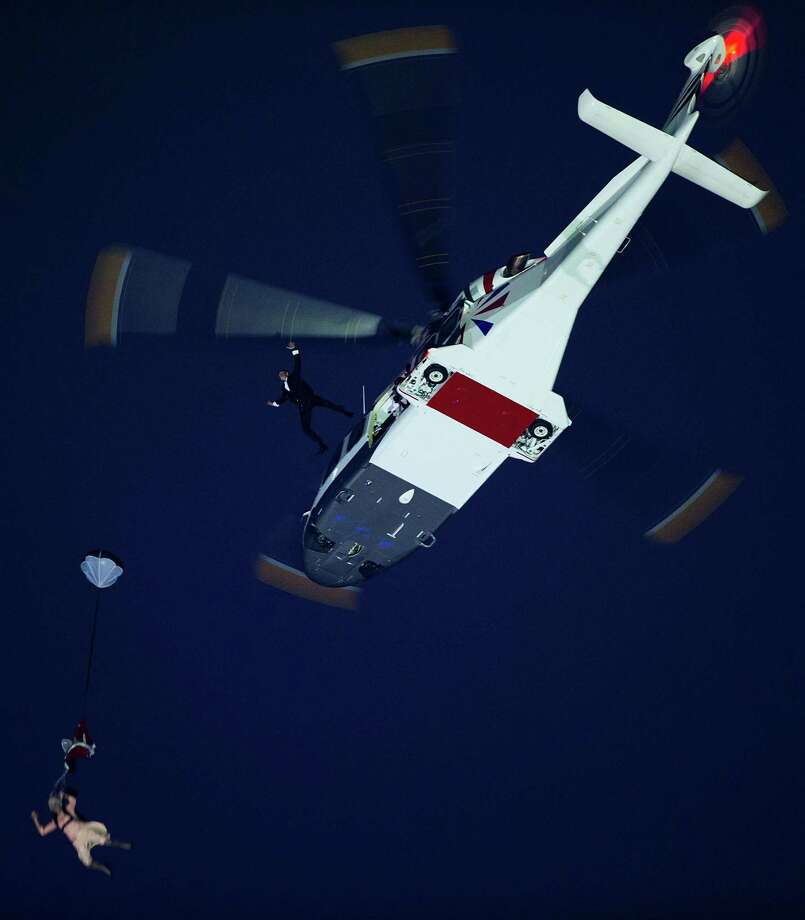 Performers depicting Queen Elizabeth and James Bond parachute from a helicopter during the opening ceremony for the 2012 London Olympics on Friday, July 27, 2012. Photo: Smiley N. Pool, Houston Chronicle / © 2012  Houston Chronicle