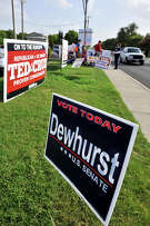 SLUG: Early voting-Photo request 58049-July 27, 2012-San Antonio, Texas---Campaign signs line the road in front of the Brookhollow Library precinct as early voting ended Friday evening. The precinct is one of the busiest in the city with Republicans vastly outnumbering Democrats.