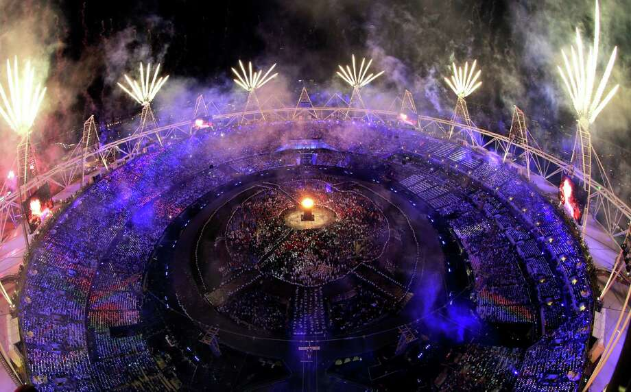 Fireworks light up over the stadium during the Opening Ceremony at the 2012 Summer Olympics, Saturday, July 28, 2012, in London. (AP Photo/David J. Phillip) Photo: David J. Phillip, STF / AP